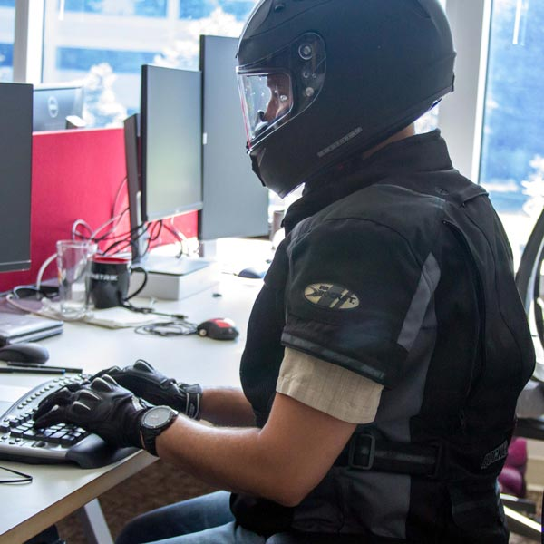 A humorous image of an employee wearing motorcycle gear to demonstrate their versatility.